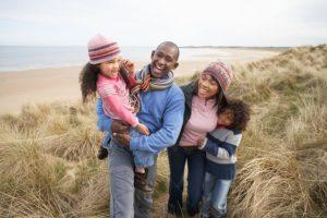 bigstock-Black-Family-on-a-beach-27384848[1]