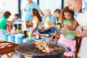 bigstock-Family-having-a-barbecue-party-20544683[1]