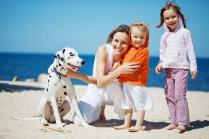 bigstock-Happy-family-resting-at-beach--12140735[1]