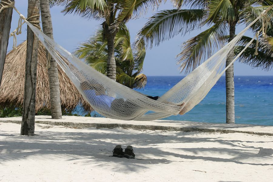 bigstockphoto_Asleep_On_The_Beach_102767