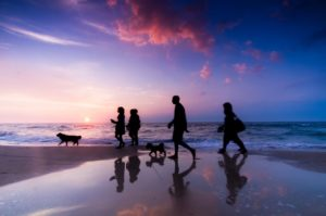 bigstock_Family_walk_on_the_beach_at_su_18950786[1]