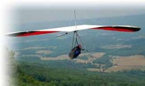Hang Glider Soaring over mountainside
