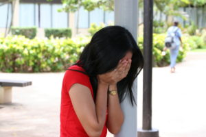 woman crying due to theft overseas