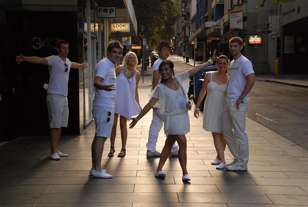 short term team on the street posing