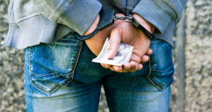 Getting arrested after offering local police a bribe - Wy you need travdl insurance with personal liability