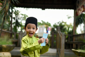 An Indonesian boy happy to get an invitation from Cinta Baca