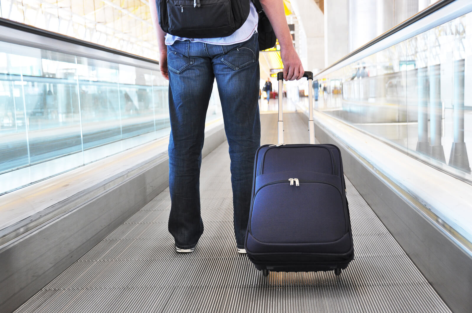 traveler with bag in airport